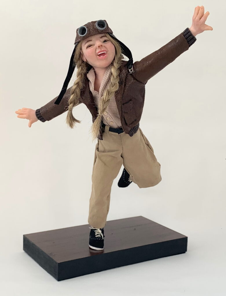 Young girl doll pretending to fly.