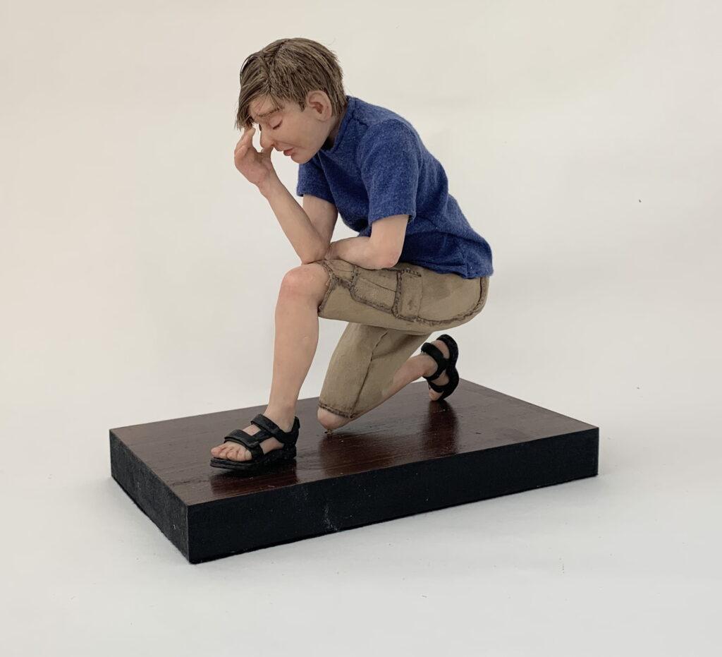 Young man kneeling.